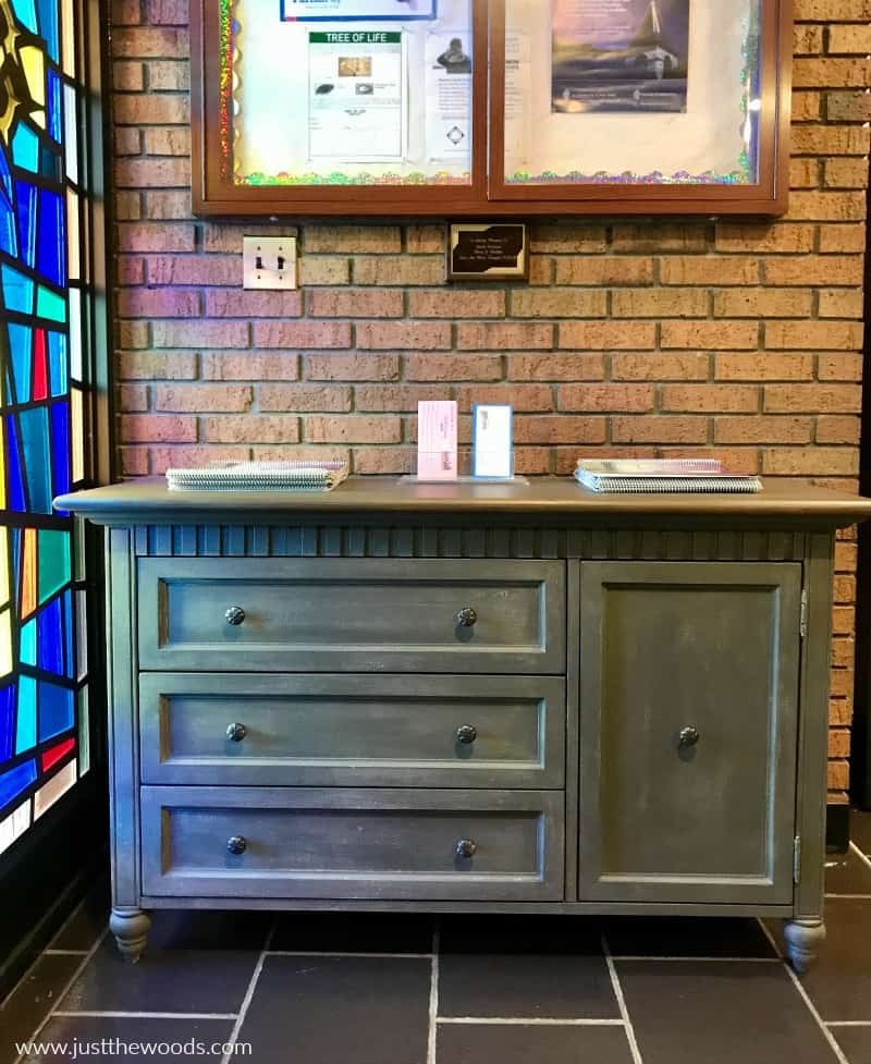 painted dresser donated to church, painted dresser next to stain glass window