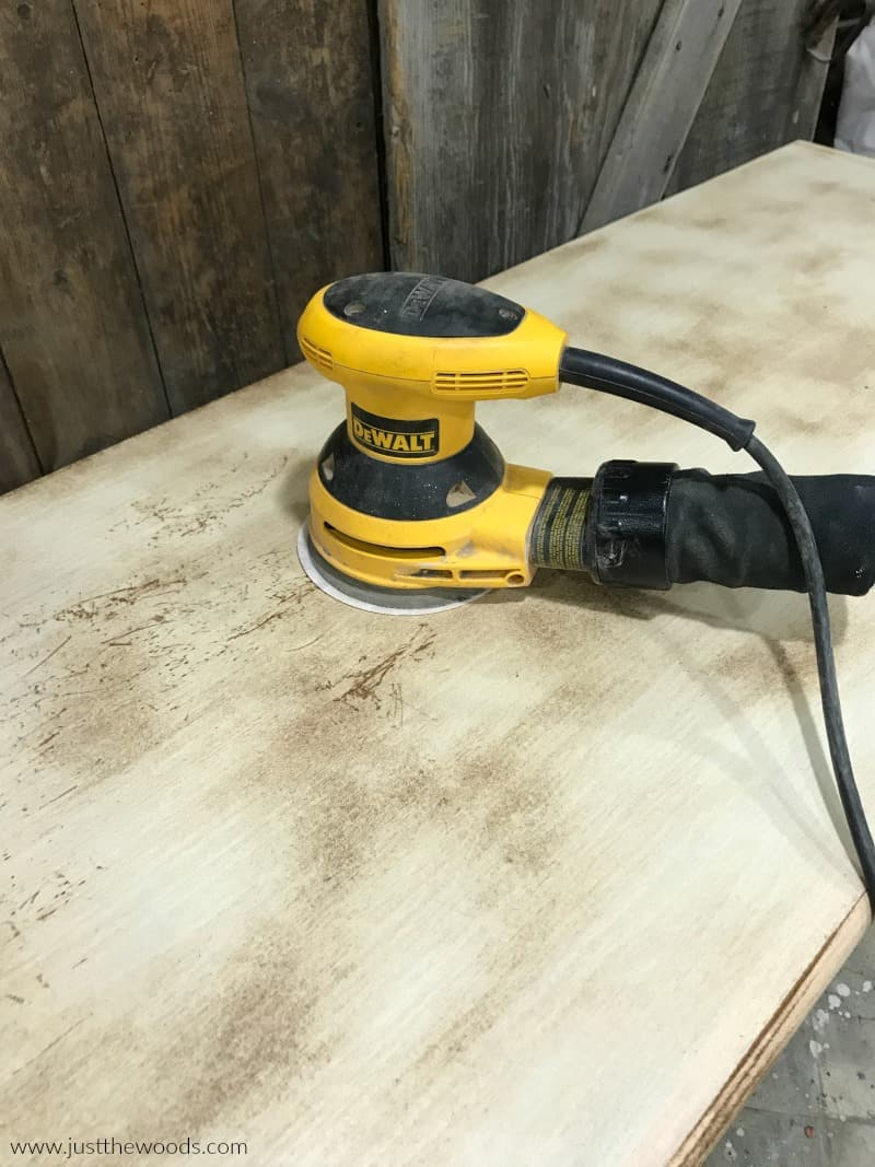 yellow dewlap sander on wood dresser
