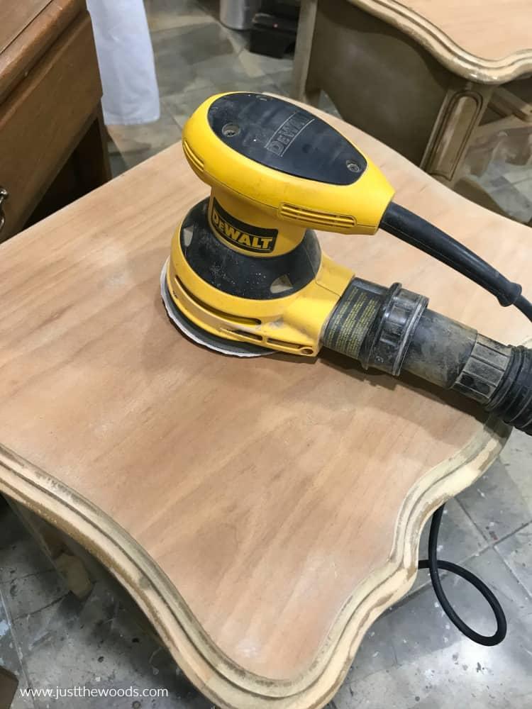 yellow electric Dewalt sander on wood table