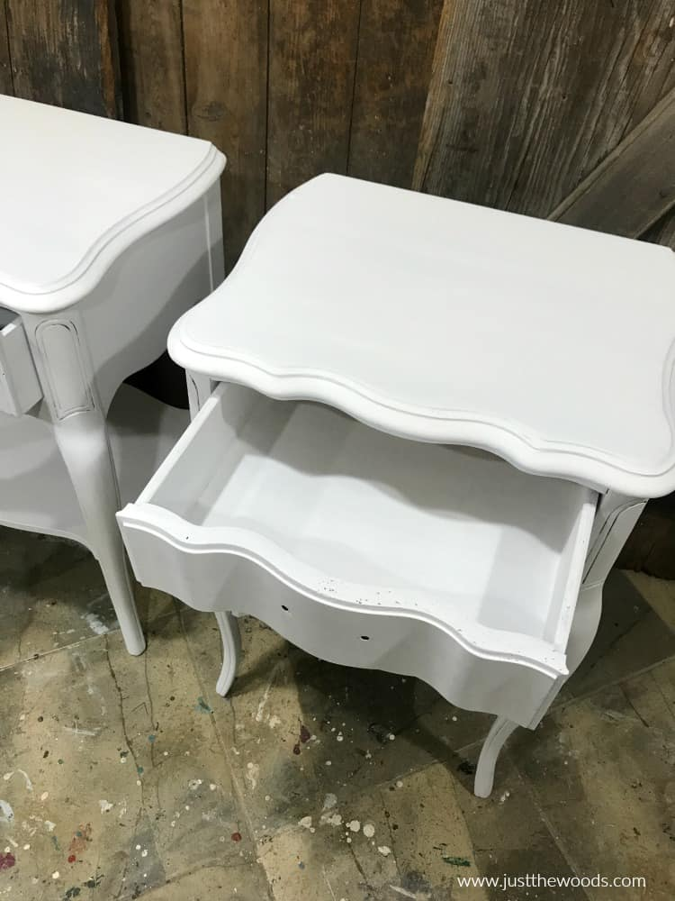 white painted tables with painted drawers