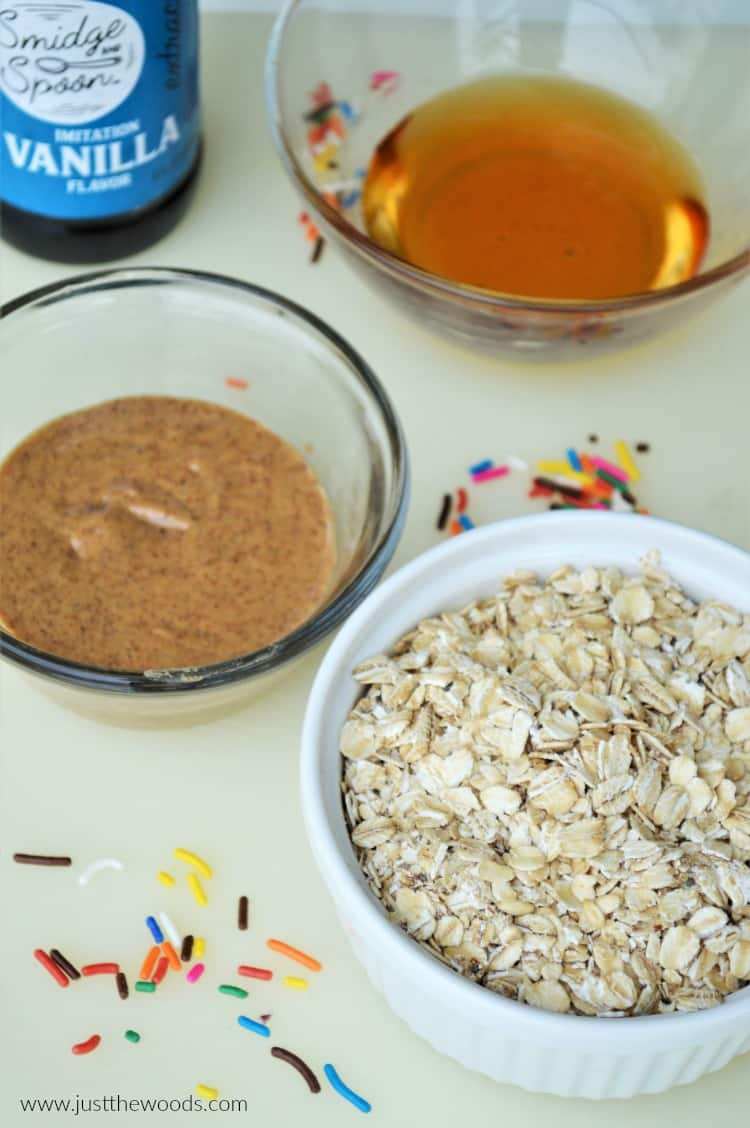 cookie dough ball ingredients, bowls of nut butter, honey and oats