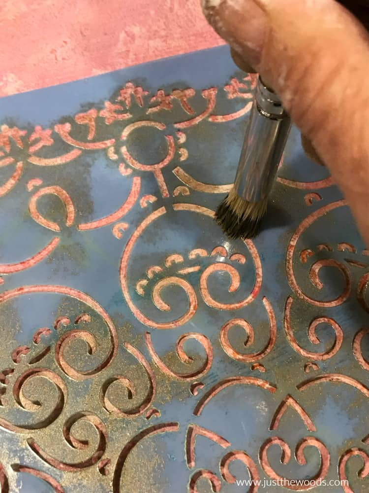 close up of stenciling metallic paint