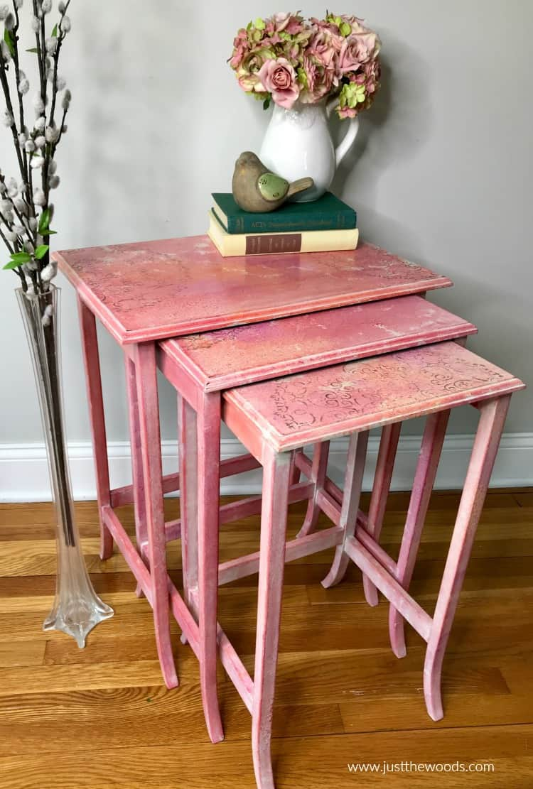 nesting tables makeover with tables pulled out, books and floral vase on top of tables