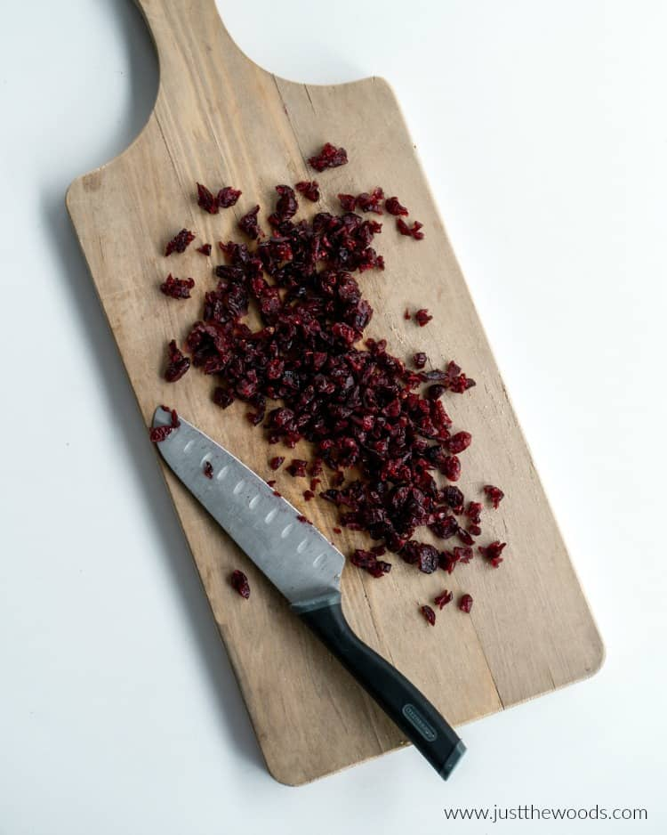 chopped cranberries on wood board