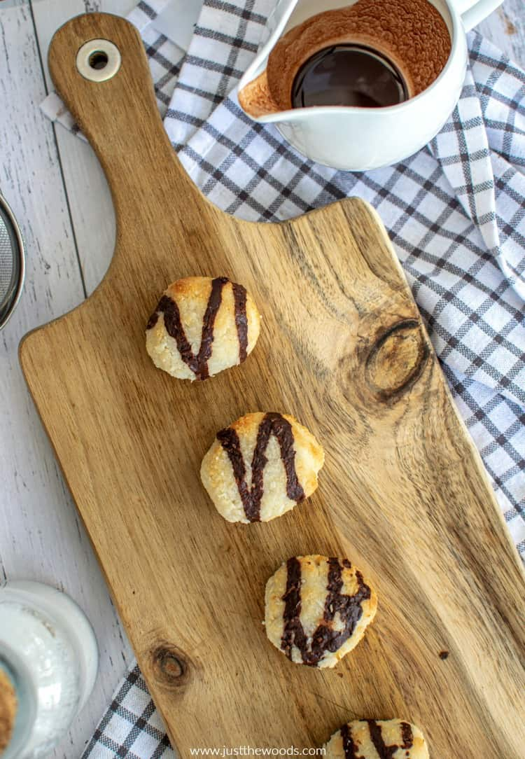 homemade gluten free macaroons on wooden board with chocolate sauce