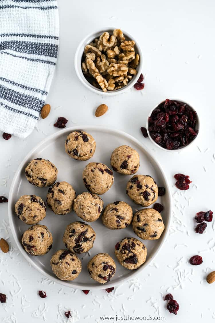 protein energy balls on plate with walnuts and cranberries