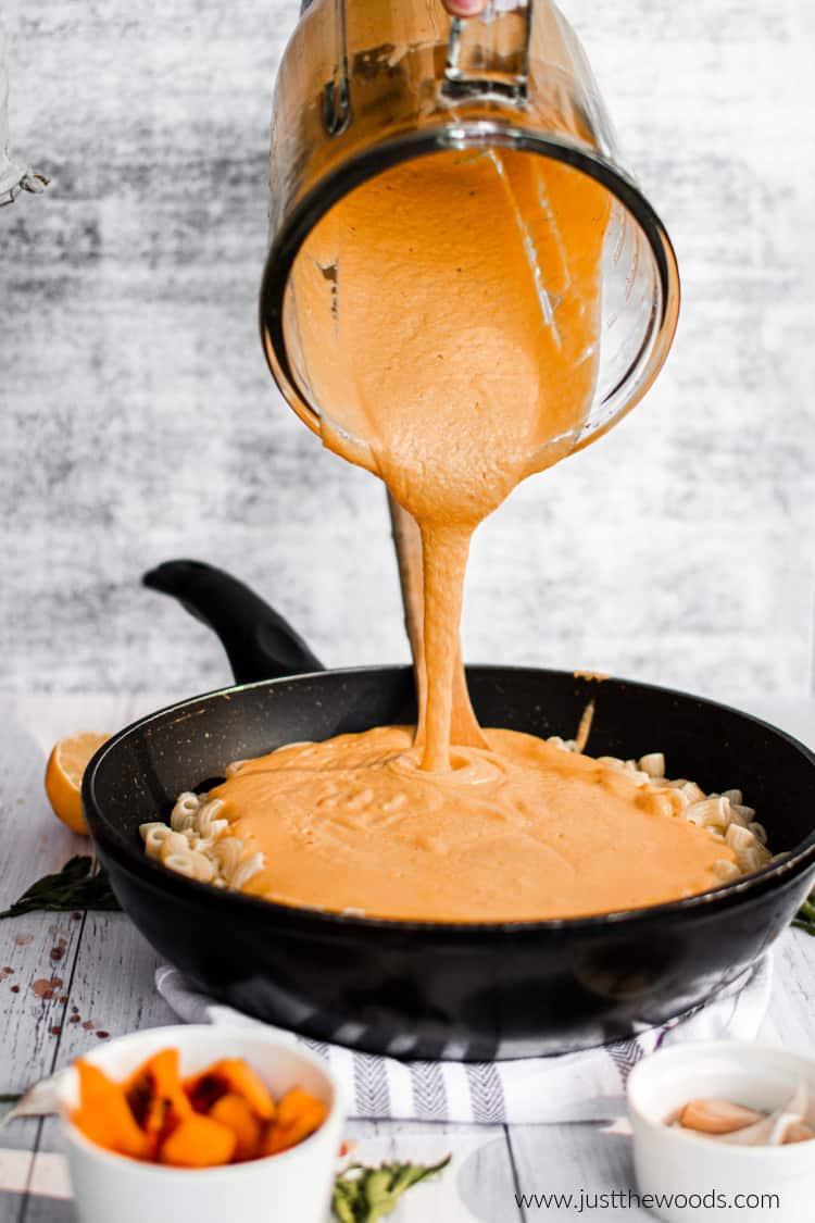 vegan cashew cheese sauce poured over gluten free pasta
